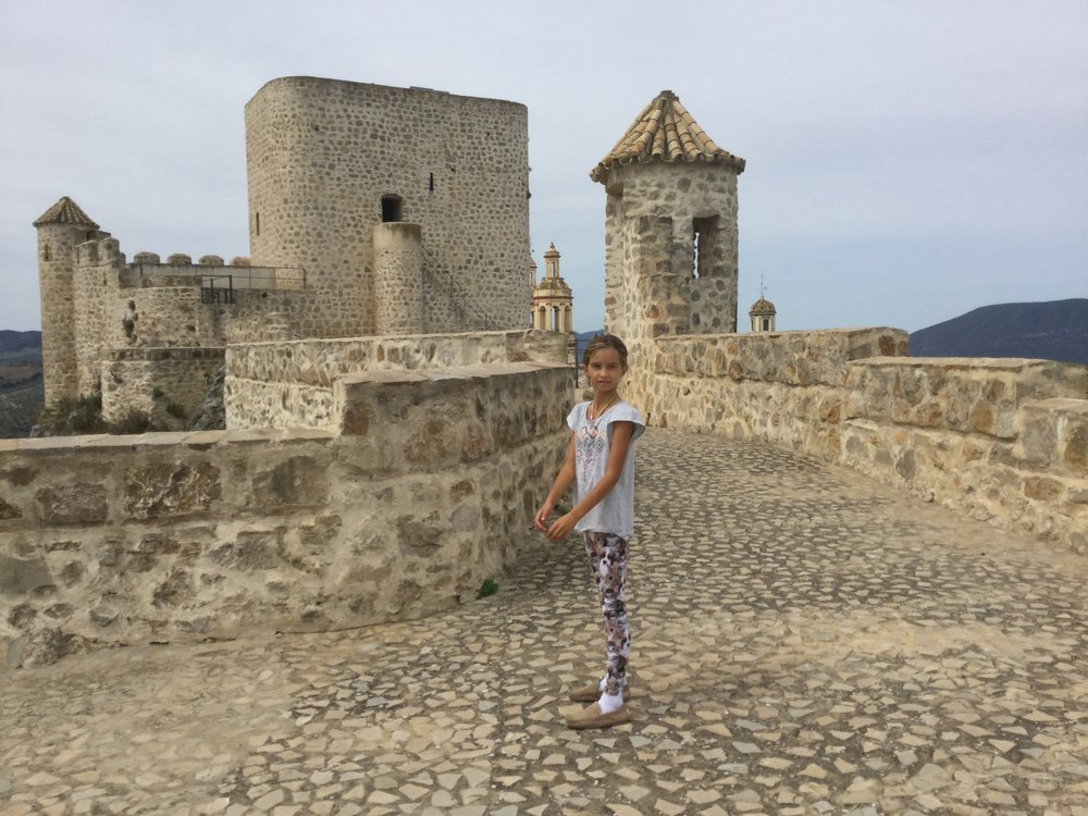 Lili the castle princess. Here is what Michelin guide says of the castle: The triangular-shaped castle built in the late 12th century was part of the Nasrid defence line, set up by the rulers of the Arab dynasty that reigned from Granada. It was taken by King Alfonso XI in 1327.