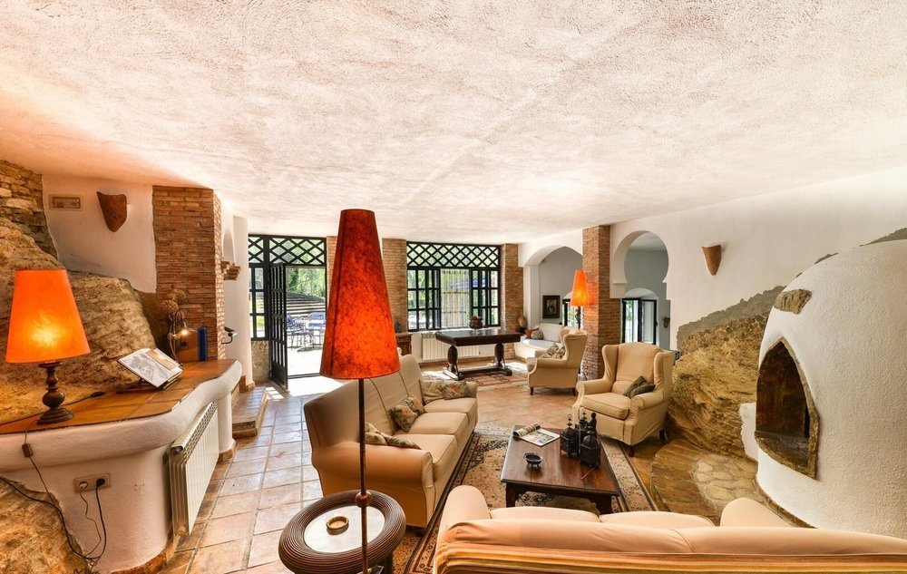 Fireplace lounge. Take note of the gorgeous exposed natural stone in the walls...