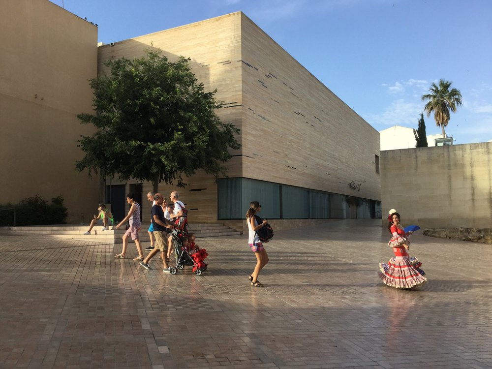 And an exclusive caption for FB readers: this very elegant modern infill building is around the corner. Cordoba had a feria while we were there and many people were decked out in full party / flamenco gear in the street.