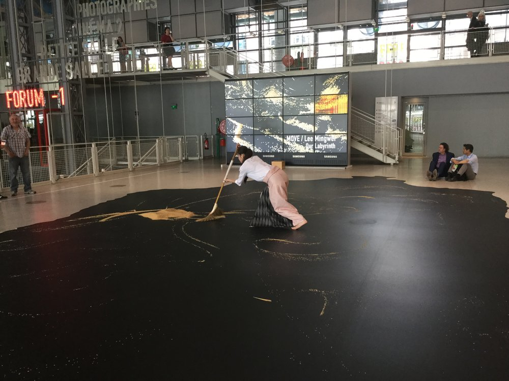 Inside an artist was doing a performance with slowly sweeping rice on a black surface. It was mesmerizing - she made it into little labyrinth-like swirls.