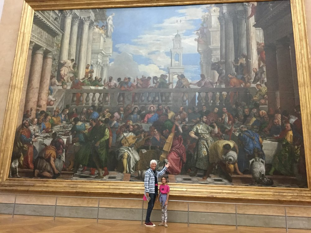 Dante wanted a picture in front of this enormous painting. It is 'Les Noces de Cana' by Veronese (Paolo Caliari), from 1563.