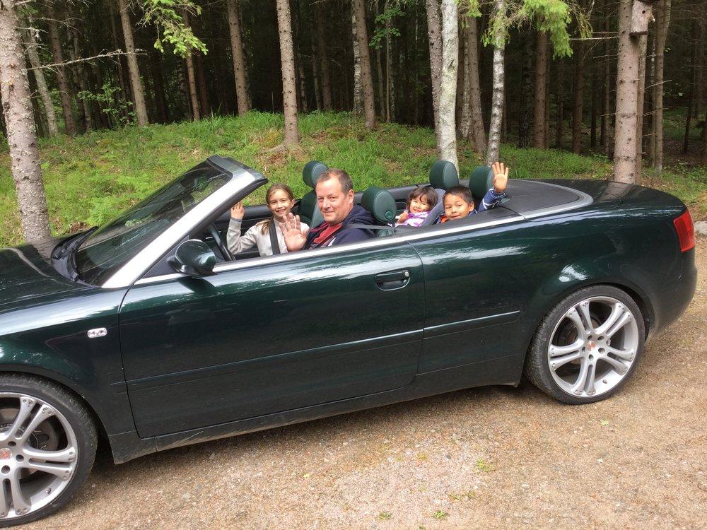 Lili got to ride in Severi's convertible. Nemo and Vivi are waving in the back.