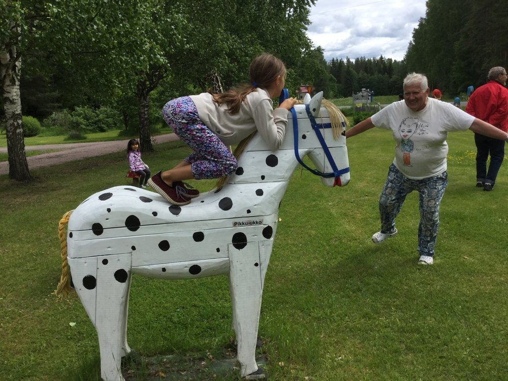 Lili in her show jumping position. Erkki being playful next to her.