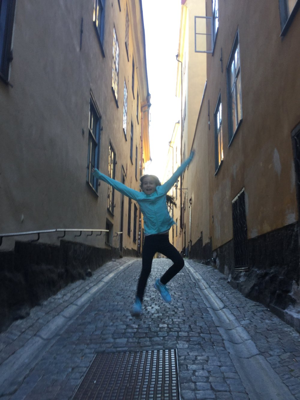 Lili doing one of her leaps in Gamla Stan.