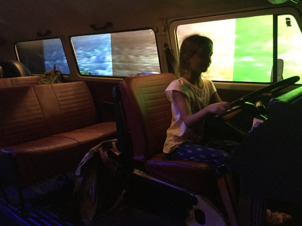 Some exhibits were iteractive. Lili inside a VW bus.