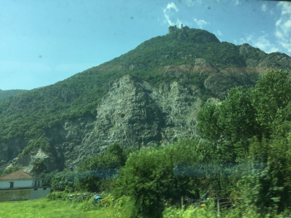 The building on the top of this mountain (seen in both photos) is Sagra di San Michele - which was the inspiration for 'The Name of te Rose' by Umberto Eco!