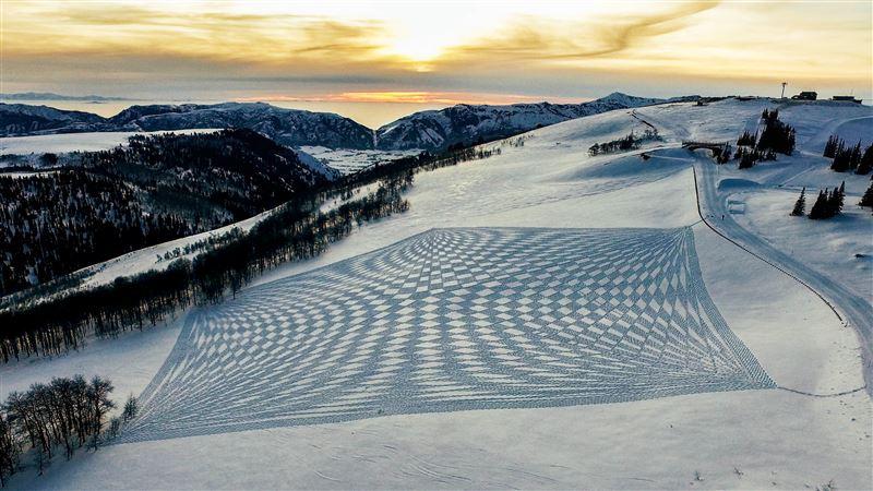 Simon Beck snow mandala, past artist in residency on Power Mountain