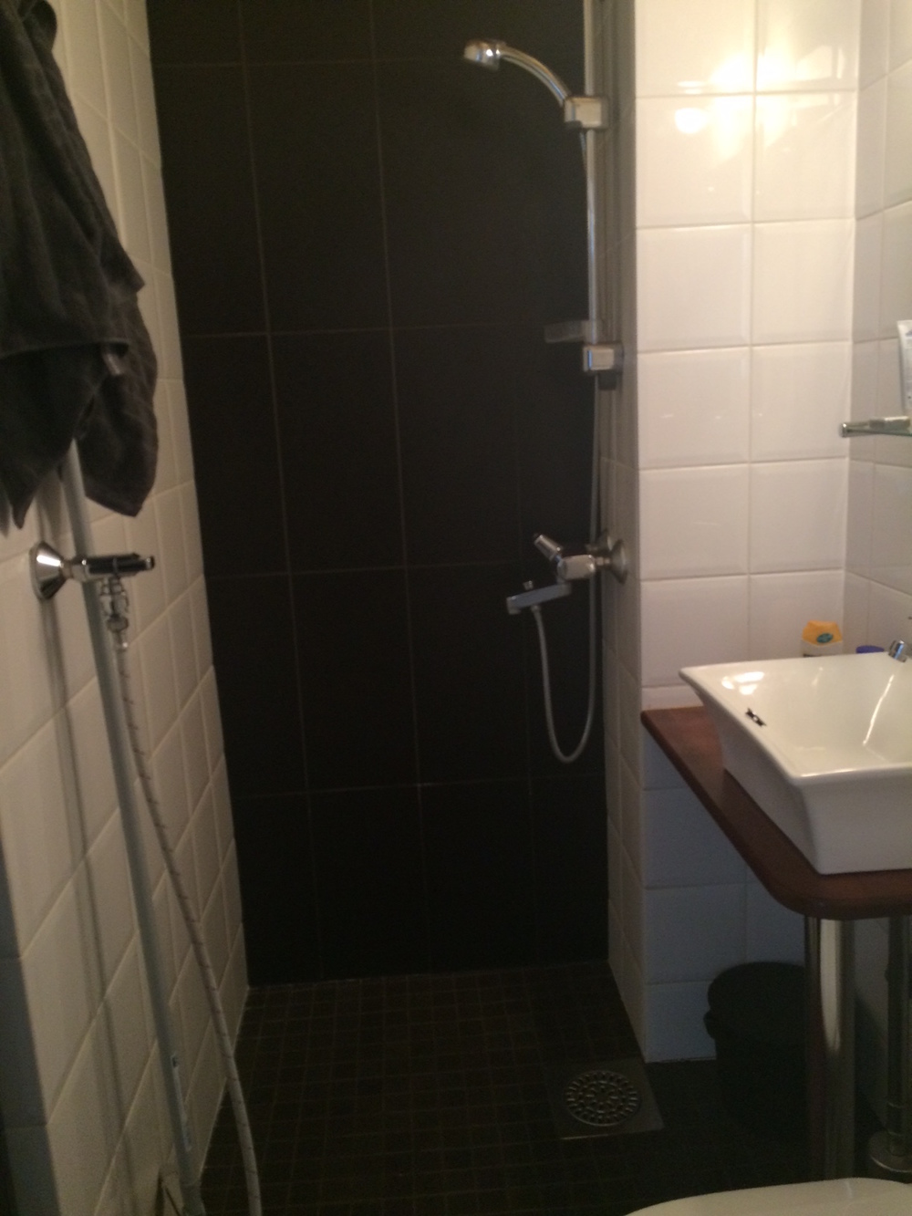 No shower curtain?  No problem.  PS.  This is our bathroom in Helsinki which is enormous compared to Copenhagen.