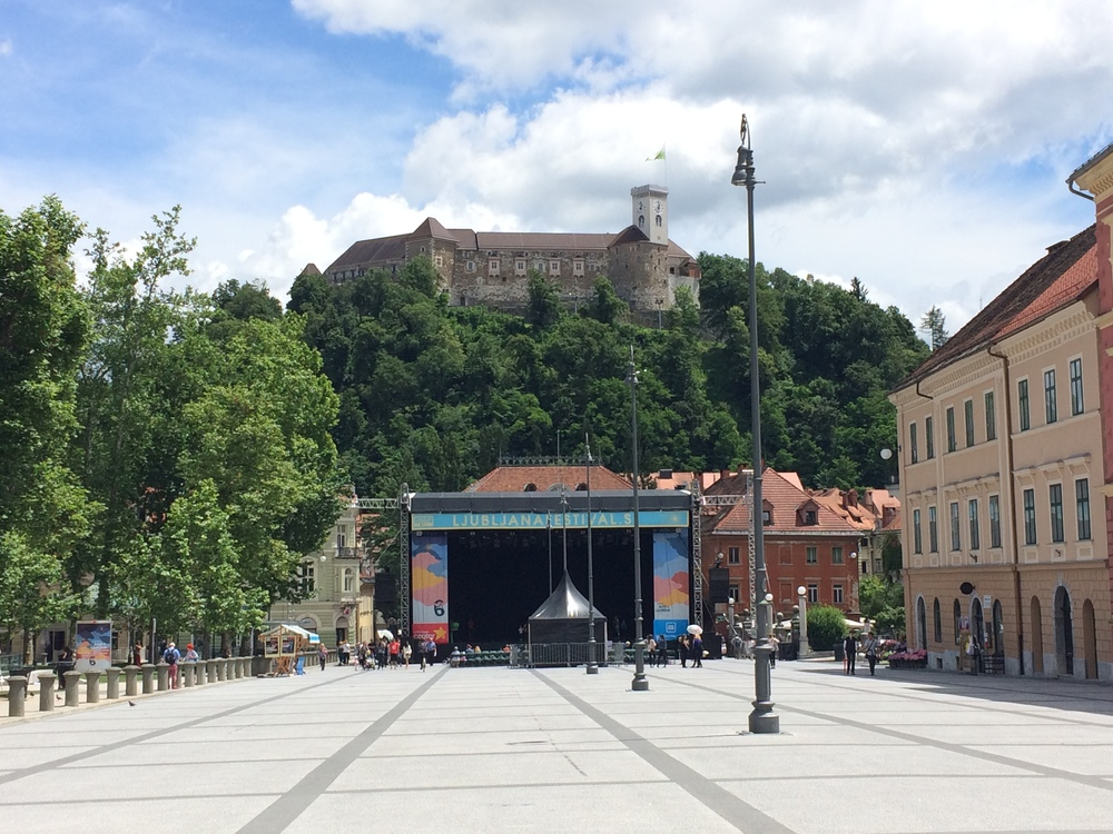 Preparing for a music festival while the Fortress looms above