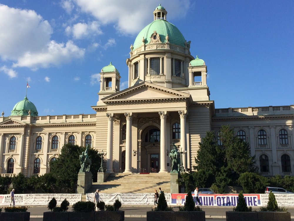 Government building. Signs outside are protests over Albanian terrorists.