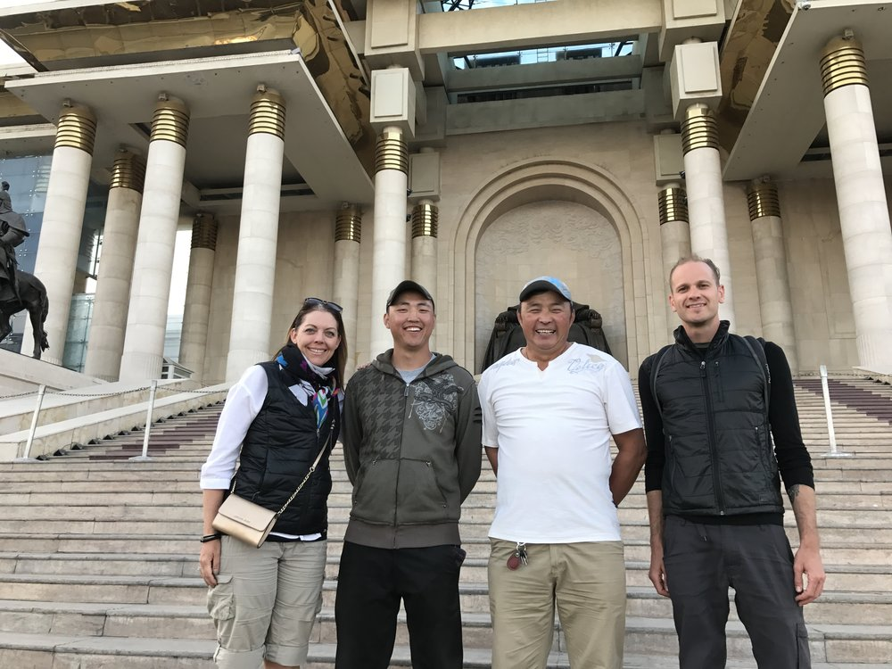 Our guide Jack (left) and driver Monkhoo (right) in front of Mongolia's parliament