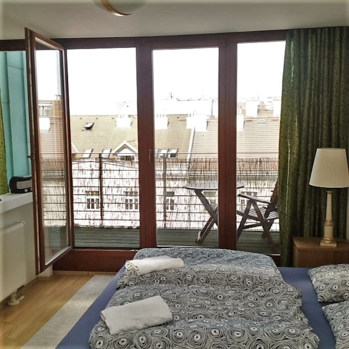 The comfortable bed and spacious balcony with great views in Prague, Czech Republic
