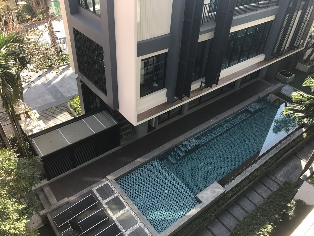Pool and workout room at a Chiang Mai, Thailand  apartment