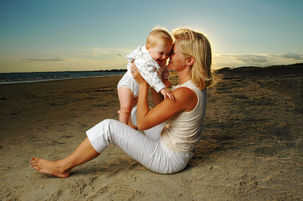 Mother & Child On Beach