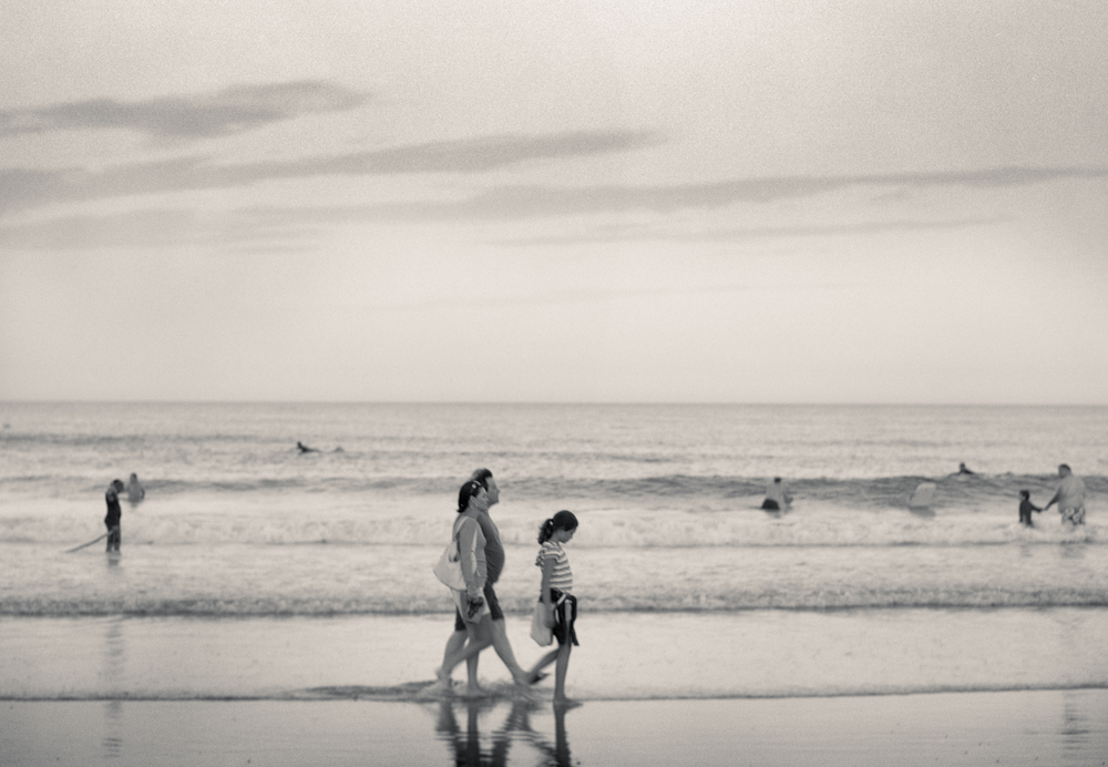 Family Walking In Surf