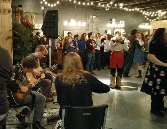 Square dancing at the Peabody Heights Brewing Company in Baltimore
