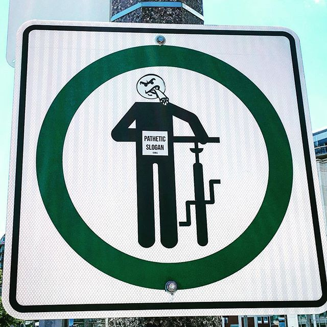 Interesting bike crossing sign..... #streetart #toronto #biking #agressive