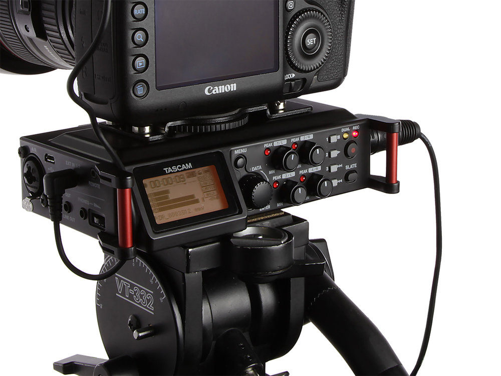 Tascam DR-70D mounted between camera and tripod.  Large controls and easy to read display make it successful