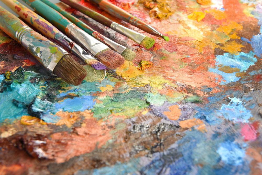 Artist Paintbrushes Over Palette