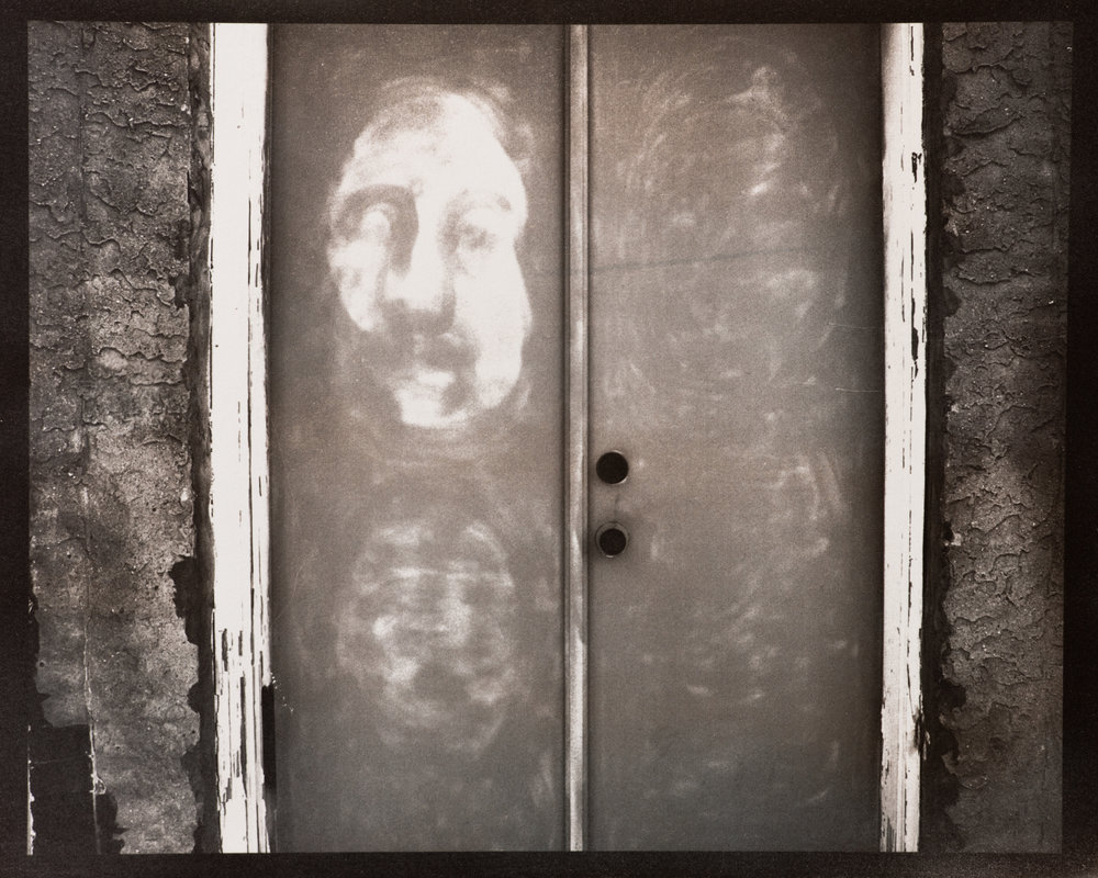 Face on a Doorway