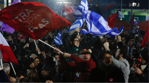 Supporters of radical leftist Syriza party chant slogans and wave Greek national and other flags after winning elections in Athens, January 25, 2015. (Reuters/AlkisKonstantinidis)