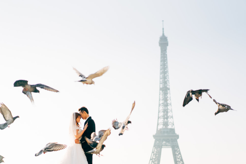 As we were waiting for our moment below, we had to work quickly as other couples and their photographer were waiting in line for us to be done. Not to mention the street vendors hawking Eiffel Tower souvenirs (Eiffel Tower keychains of all sizes and colours)