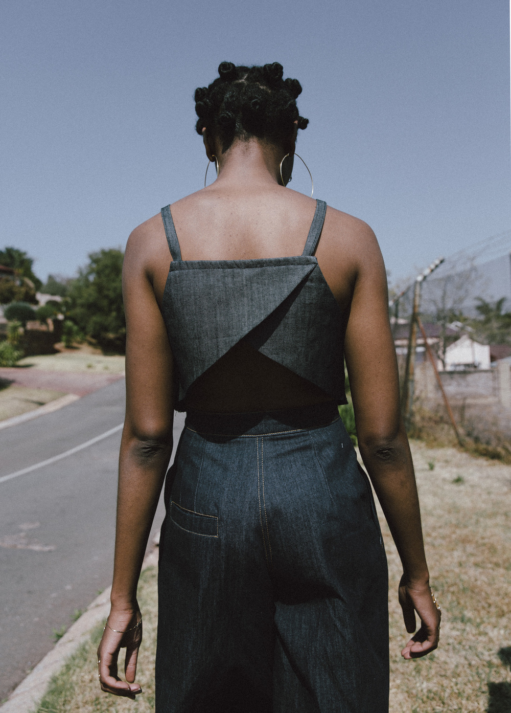 Lindiwe wears earrings, Lulubelle; crop top, Akedo; culottes, Oath Studio
