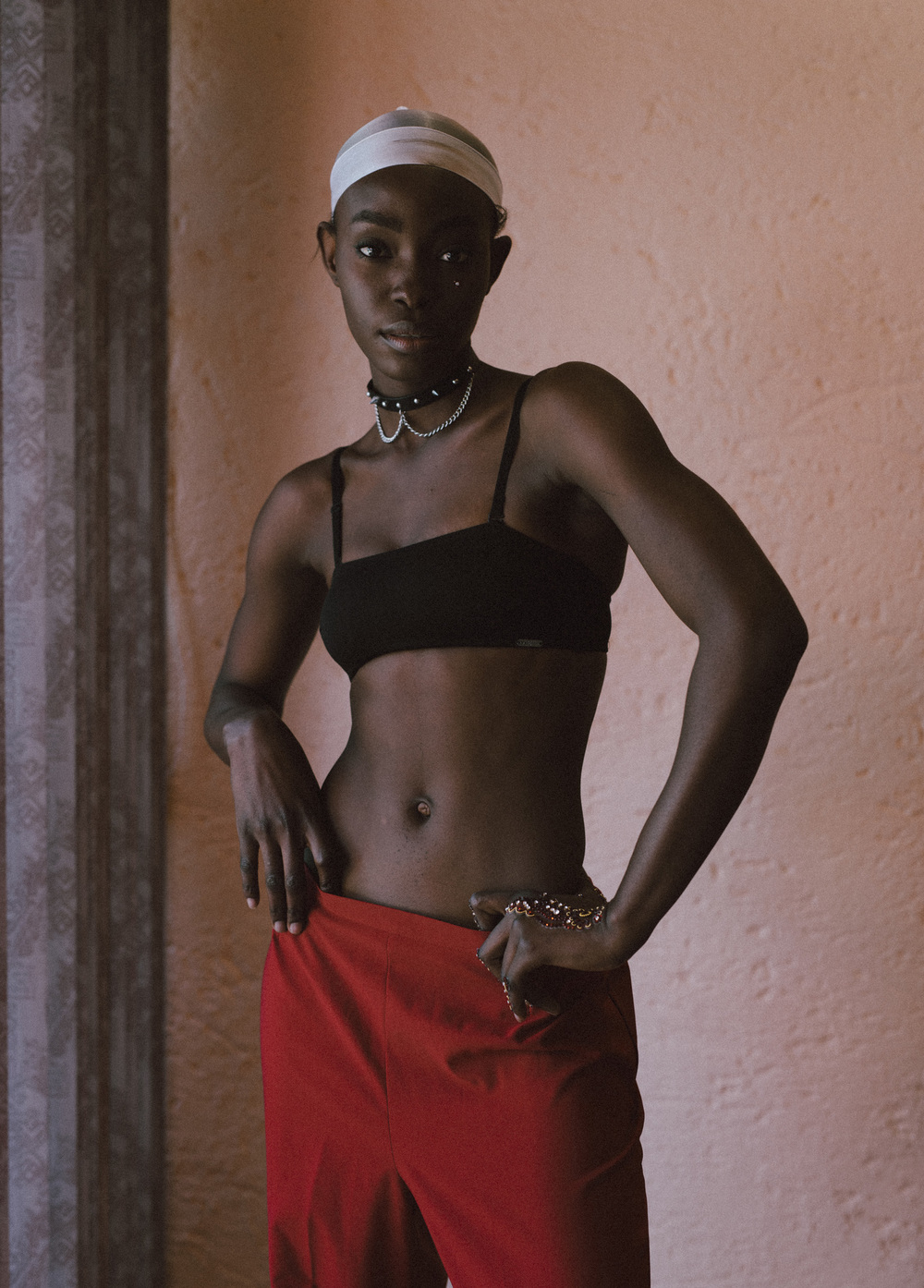 Janet wears do-rag, Oriental Plaza; leather choker, model's own; cami bra, Total Sports; trousers, Second Time Around
