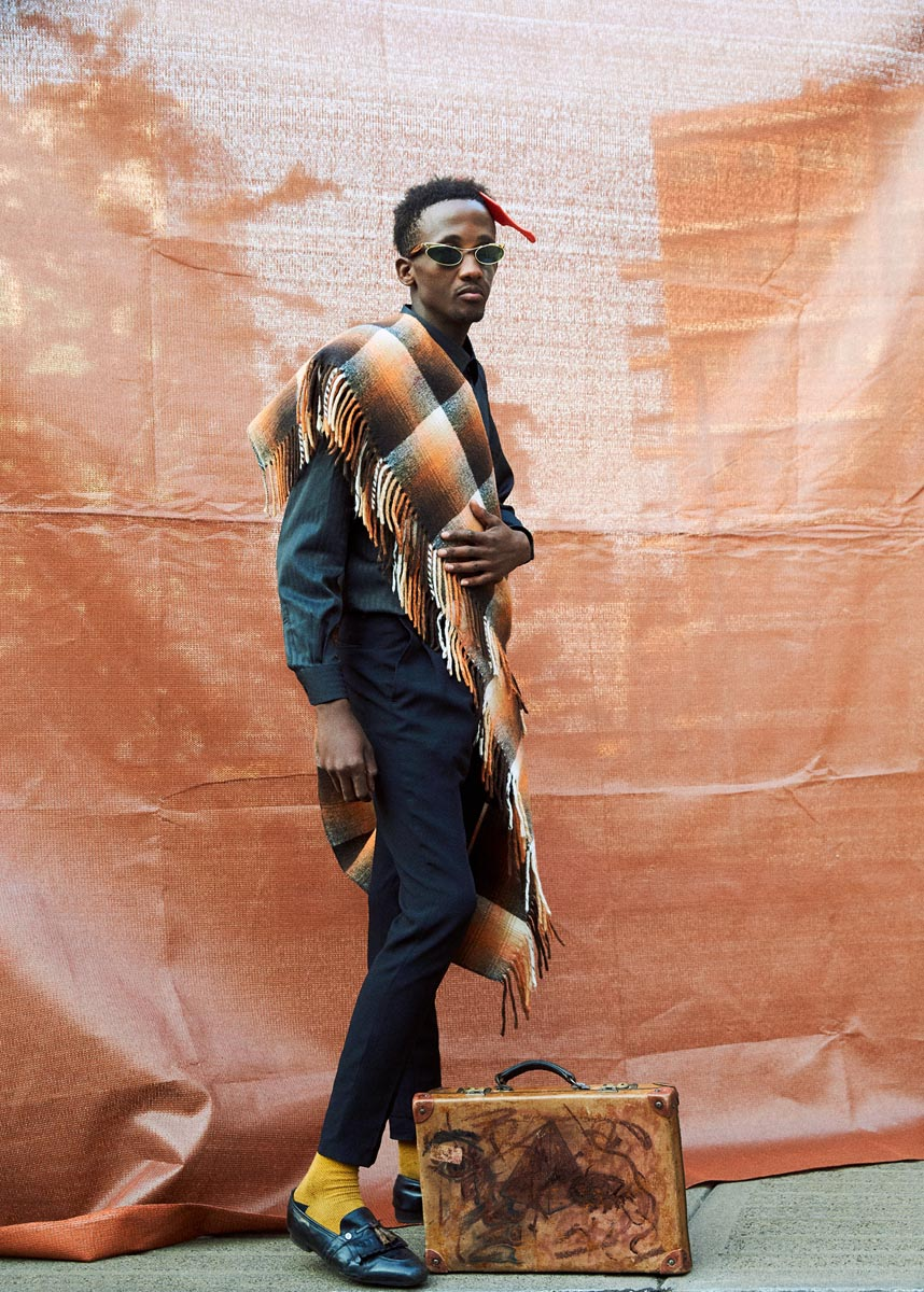 """Obakeng Mogapi """"My style is vintage. It's a lifestyle and it comes from the streets. That old lady who always carries a blanket on her back, that ou toppie (old man) that always has his tailor made cup..."""""""