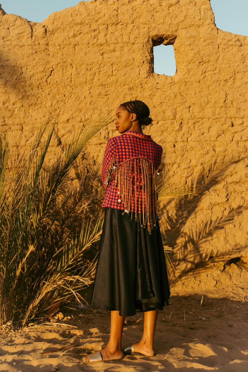3 of 3 - Izy wears Jamie Kimani jacket, M+K skirt (worn as dress), stylist's own jewellery