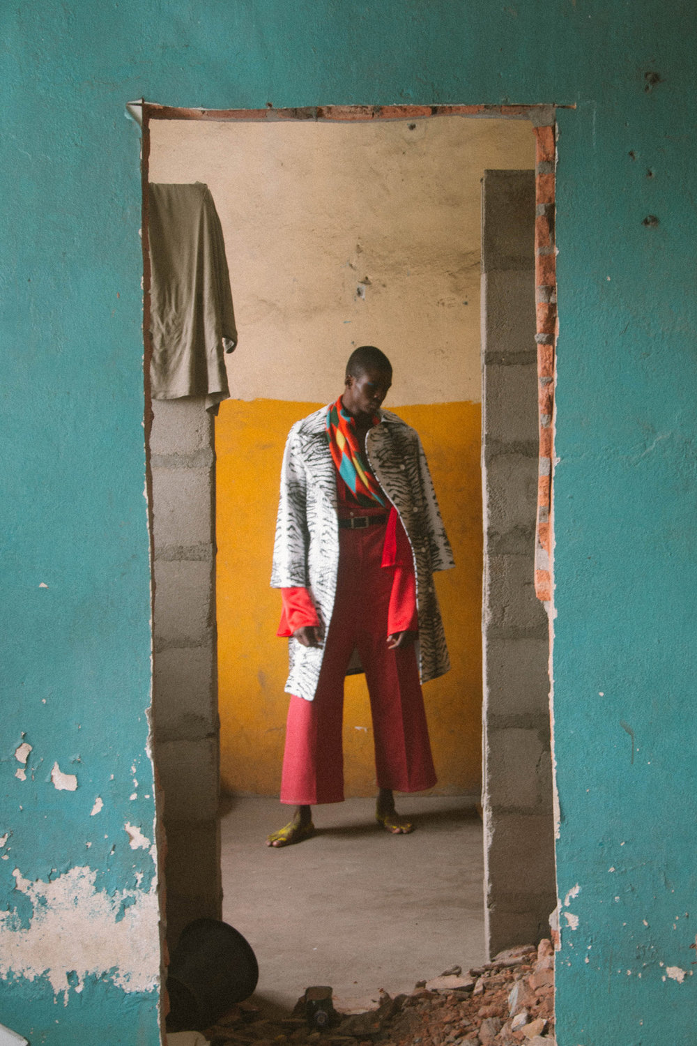 Rich Mnisi jacket, Re shirt, Thebe Magugu trousers and belt, Chulaap scarf