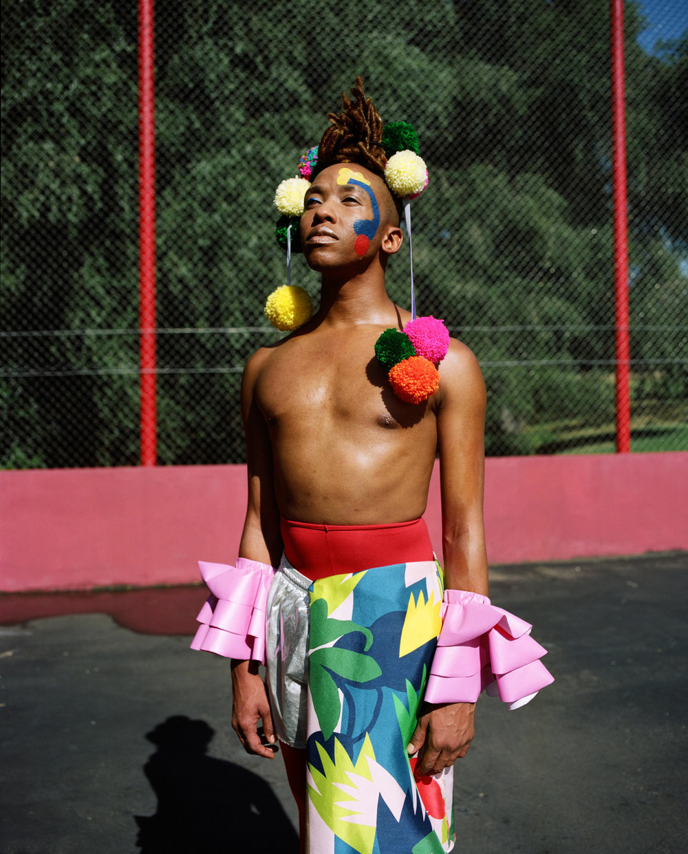 Umlilo wears The Real Crystal Birch crown, Martelle Ludik cuffs, Sindiso Khumalo blouse (worn as apron), American Apparel shorts, Falke tights