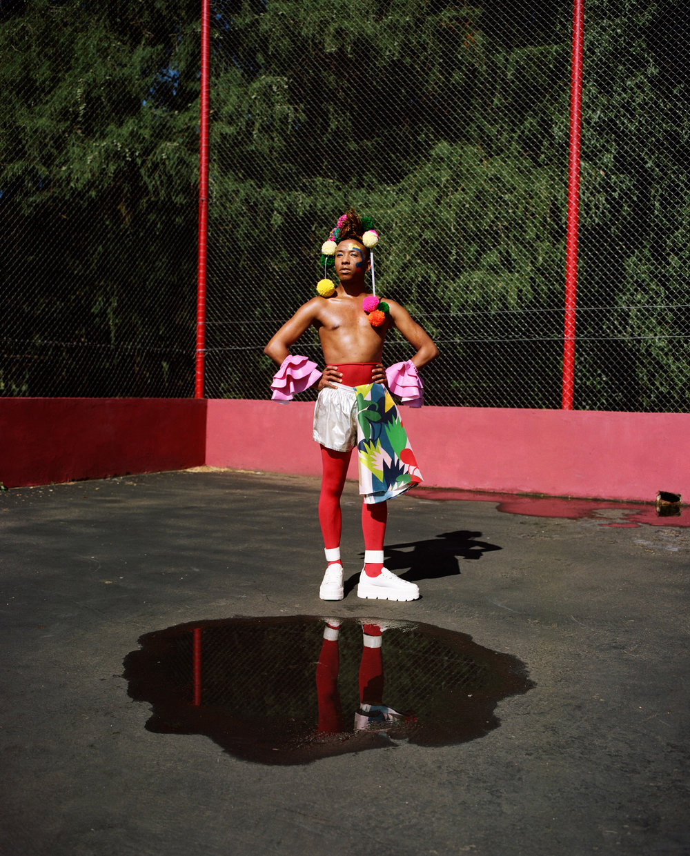 Umlilo wears The Real Crystal Birch crown, Martelle Ludik cuffs, Sindiso Khumalo blouse (worn as apron), American Apparel shorts, Falke tights, Fenty for Puma platforms