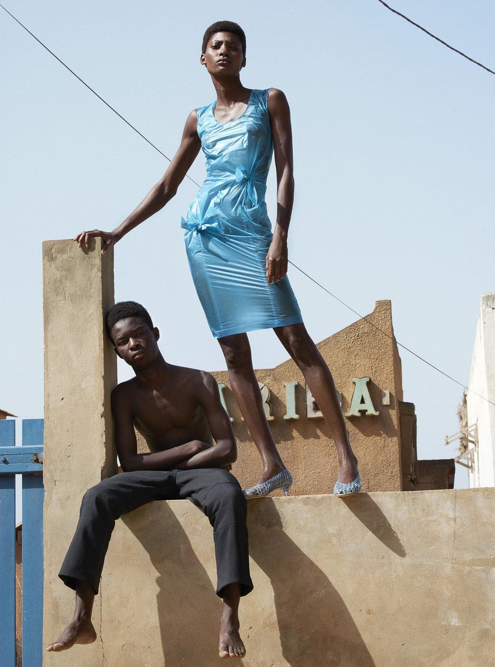 Mame wears HELMUT LANG dress, MARY KATRANTZOU shoes. Male model wears KENZO trousers.
