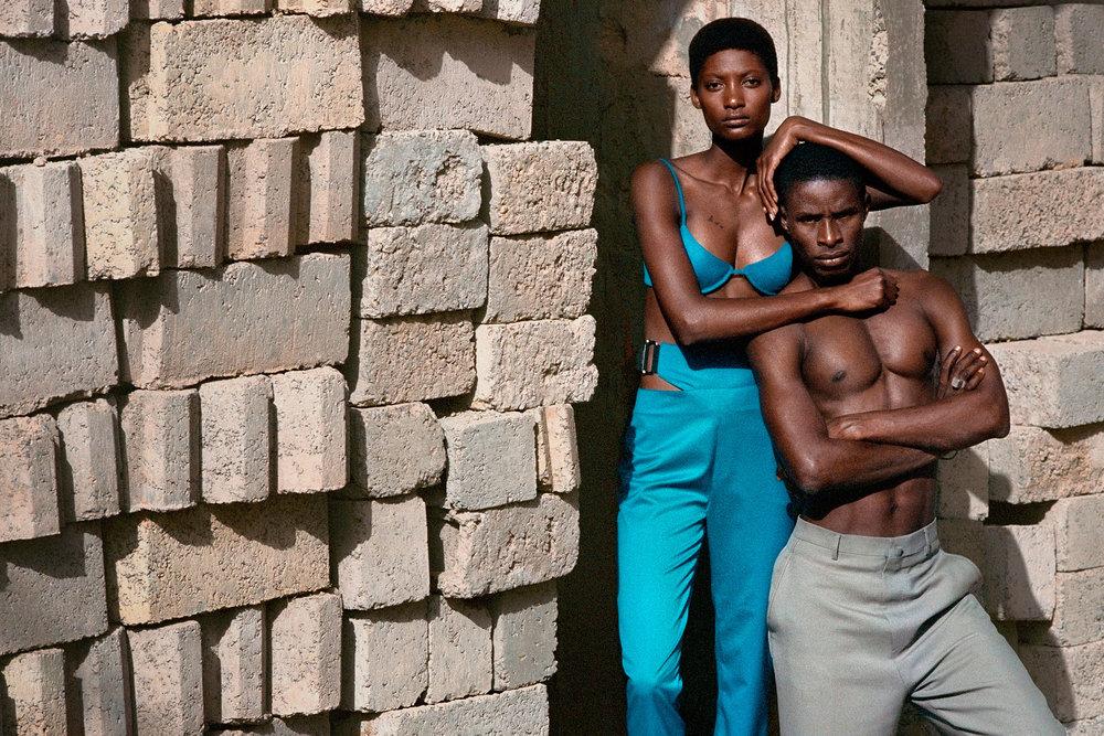 Mame wears HELMUT LANG bra and trousers. Male model wears LANVIN trousers.