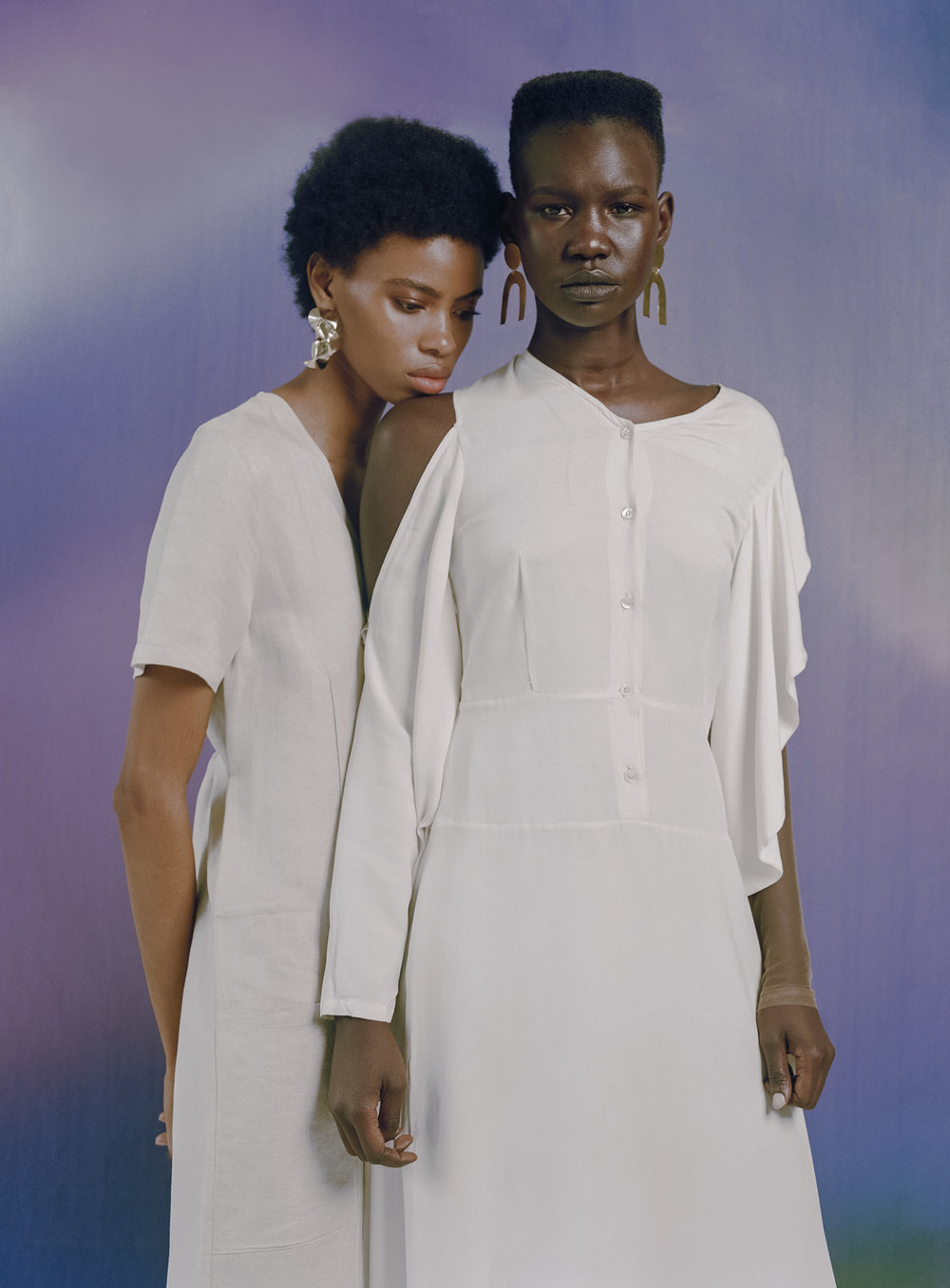 Raschelle wears MAKI OH jumpsuit, CASTLECLIFF NYC earrings. Adot wears MAKI OH dress, ONE STORY earrings.