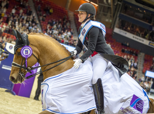 """That's my boy!"" Denmark's Cathrine Dufour brought the crowd to their feet with a brilliant winning performance from her lovely gelding Atterupgaards Cassidy at the eighth leg of the FEI World Cup™ Dressage 2017/2018 Western European League in Gothenburg (SWE) today. (FEI/Arnd Bronkhorst)"