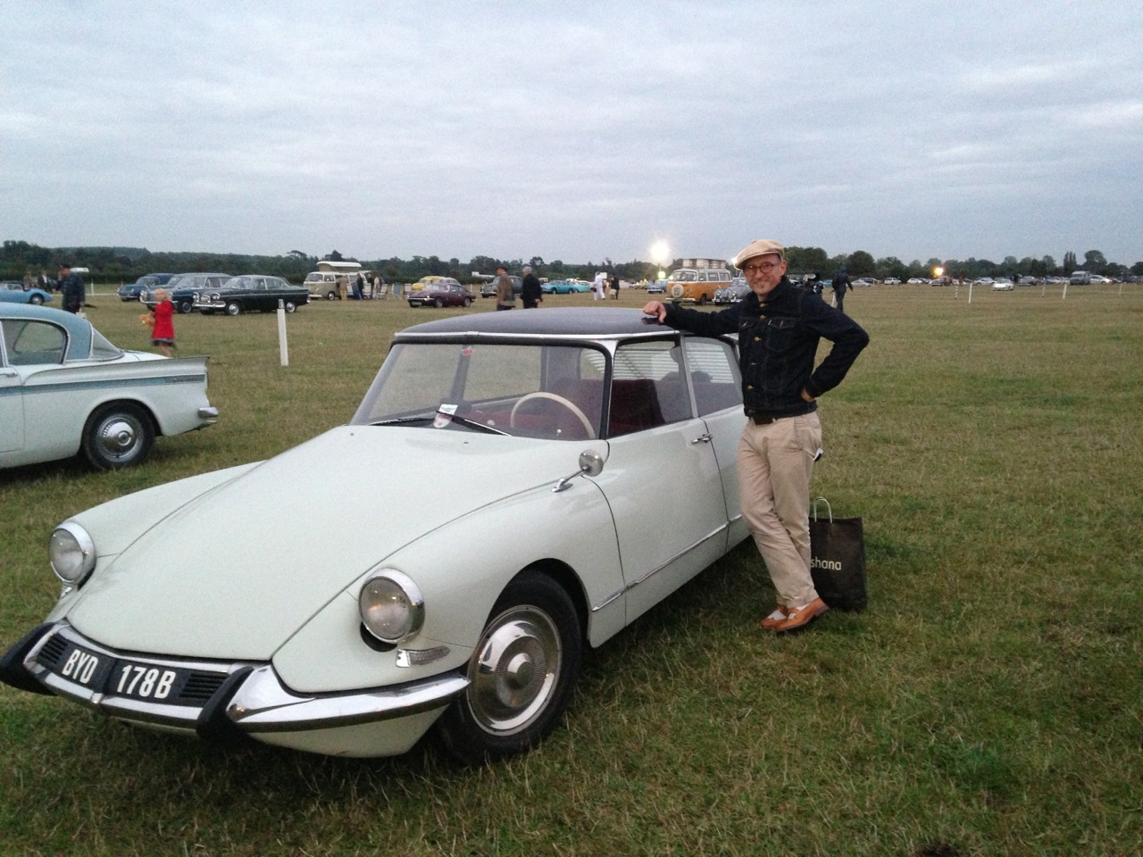 Chiropractorfin leaning on his fantasy car at Goodwood Revival