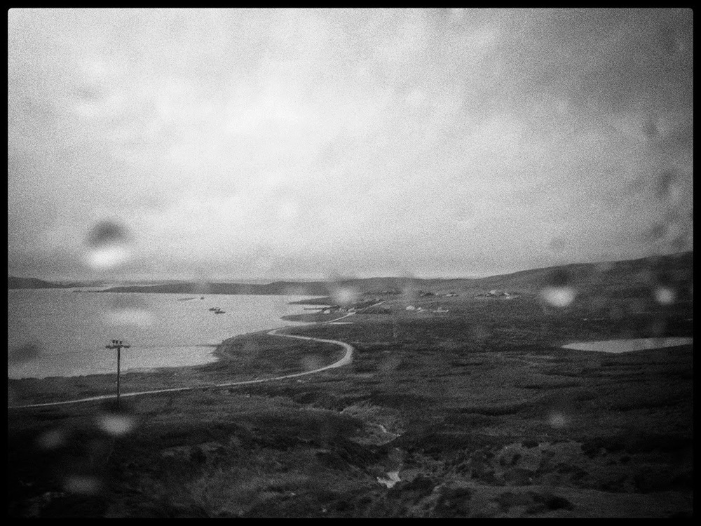 Shetland Voe black white water rain drops path road bad weather window drissle drizzle telegraph pole peat