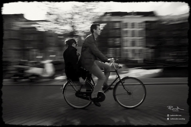 bicycle ride Amsterdam moving camera panning backie tows up
