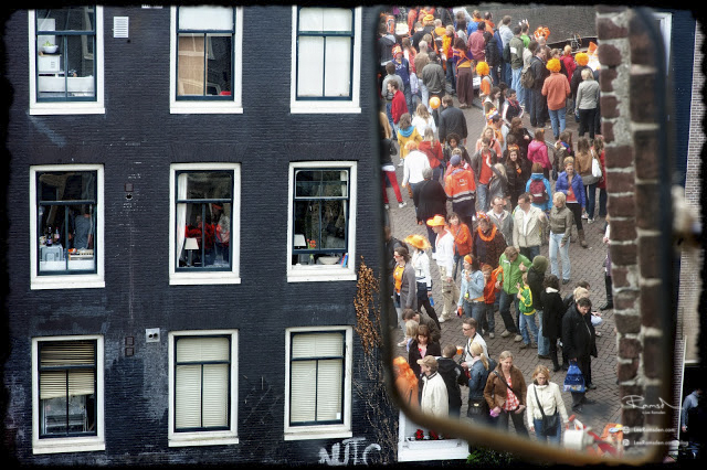 Mirror view reflection Amsterdam Queens day Kings day celebrations orange