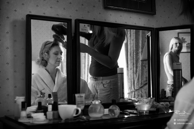 Mr and Mrs Morris wedding photography Hertfordshire bride getting ready in the mirror