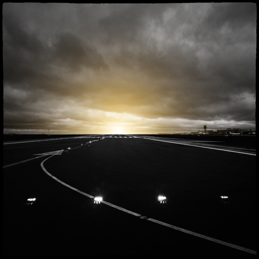 Sun set rise at the end of the runway Manchester airport stylised art