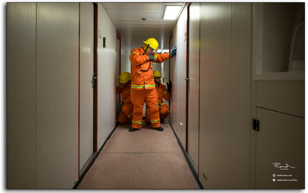 fire men, accomodation fire, exercise, drill, practice, door technique, door drills, back of hand, testing, Jim Coyle, James Coyle, north sea, offshore, oil and gas industry, photo by, Lee Ramsden