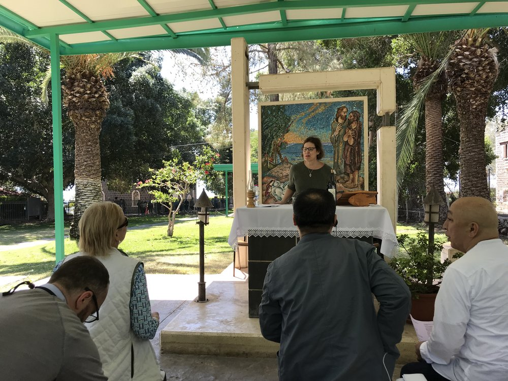 Dean Laird celebrates Eucharist in the gardens of the Church of the Primacy of Saint Peter