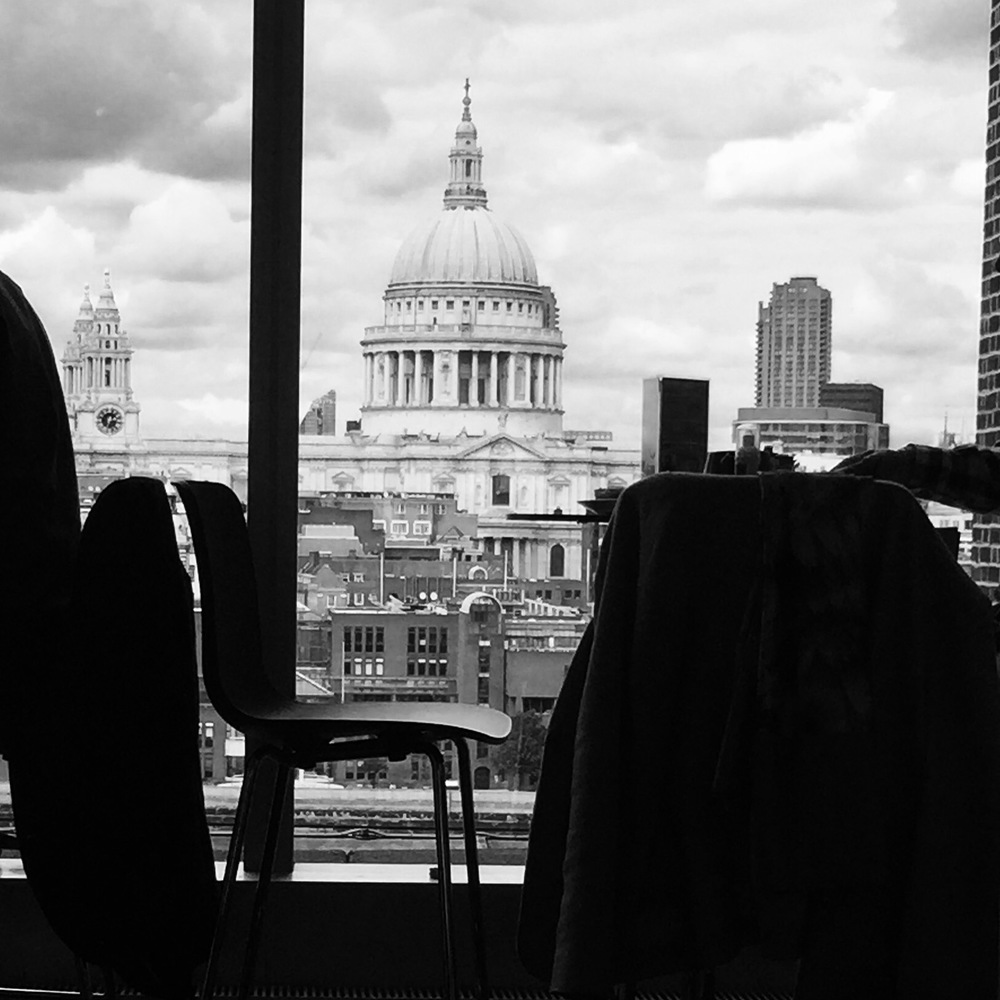 Inside Tate Modern, looking outside to St Paul's Cathedral.