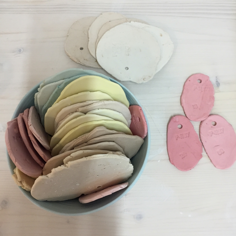 Porcelain colour samples on the workbench in Elliott's studio.