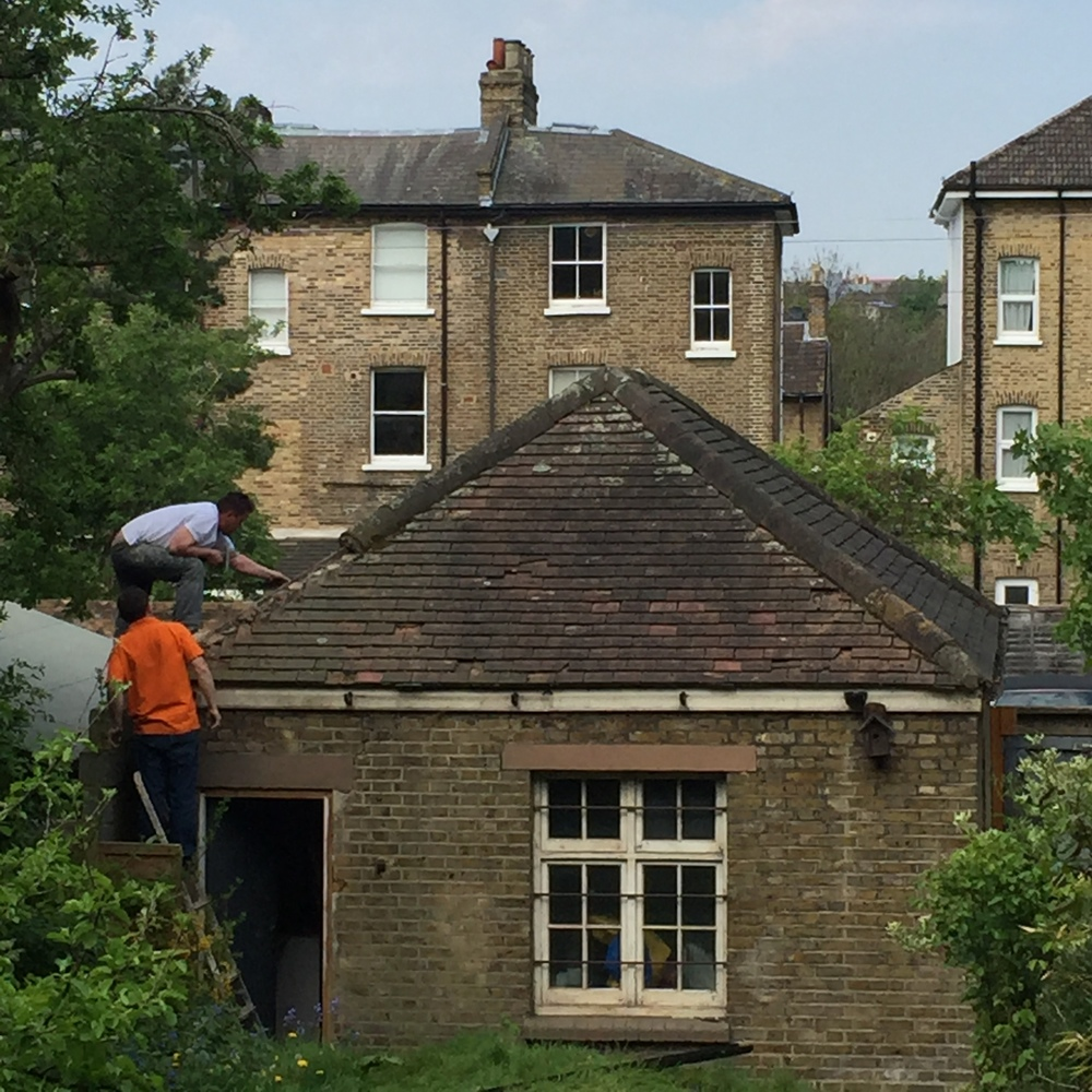 Builder on the roof: tiles coming off, one-by-one.