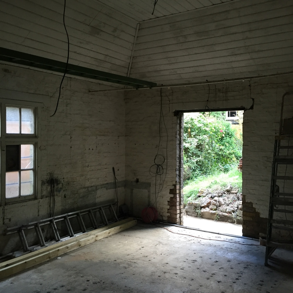 Let there be light: the window is removed to allow for a wide door into the garden.