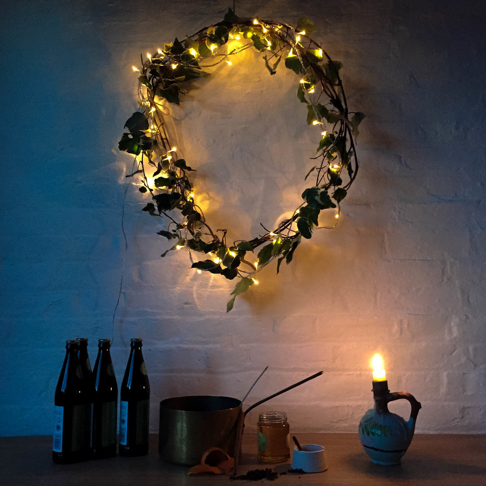 Simple Shape Christmas Pop-Up: twinkly lights, greenery, cider and nice things.